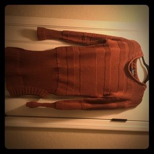 Rust-colored tunic sweater with hip detail